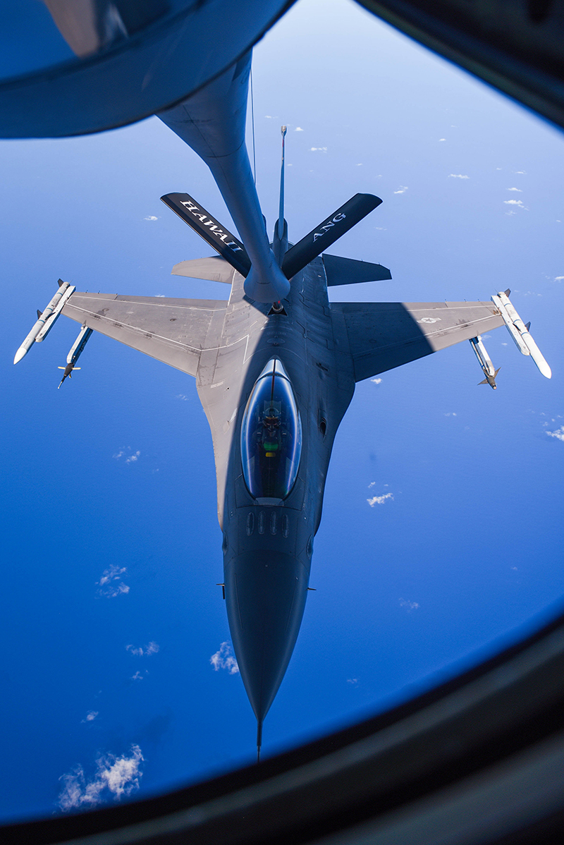 A United States Air Force F-16 Fighting Falcon from Tulsa Air National Guard Base in Tulsa, Oklahoma, receives fuel from a Hawaii Air National Guard KC-135 over the Pacific Ocean during the Sentry Aloha exercise at Joint Base Pearl Harbor-Hickam, August 27, 2019. Aircraft from around the world took part in Joint Exercise Sentry Aloha, a three week coalition exercise at Joint Base Pearl Harbor-Hickam in Honolulu, Hawaii. (U.S. Air National Guard Photo by Airman First Class Adam Smith)