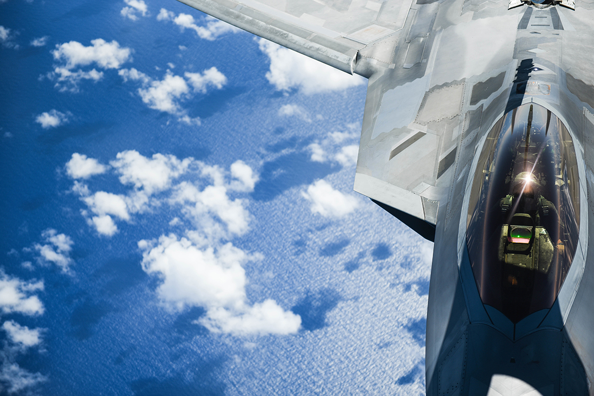 A United States Air Force F-22 Raptor from Joint Base Pearl Harbor-Hickam in Honolulu, Hawaii, receives fuel from a Hawaii Air National Guard KC-135 over the Pacific Ocean during the Sentry Aloha exercise at Joint Base Pearl Harbor-Hickam, August 27, 2019. Aircraft from around the world took part in Joint Exercise Sentry Aloha, a three week coalition exercise at Joint Base Pearl Harbor-Hickam in Honolulu, Hawaii. (U.S. Air National Guard Photo by Airman First Class Adam Smith)