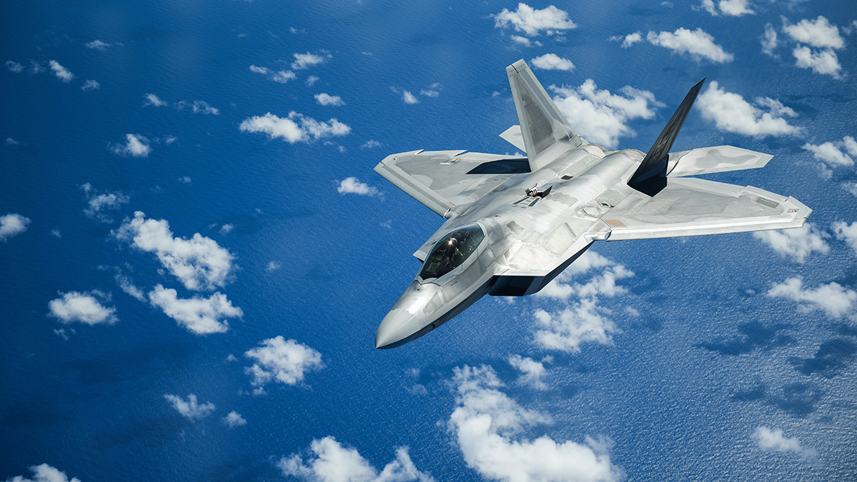 A United States Air Force F-22 Raptor from Joint Base Pearl Harbor-Hickam in Honolulu, Hawaii, flies over the Pacific Ocean during the Sentry Aloha exercise at Joint Base Pearl Harbor-Hickam, August 27, 2019. Aircraft from around the world took part in Joint Exercise Sentry Aloha, a three week coalition exercise at Joint Base Pearl Harbor-Hickam in Honolulu, Hawaii. (U.S. Air National Guard Photo by Airman First Class Adam Smith)