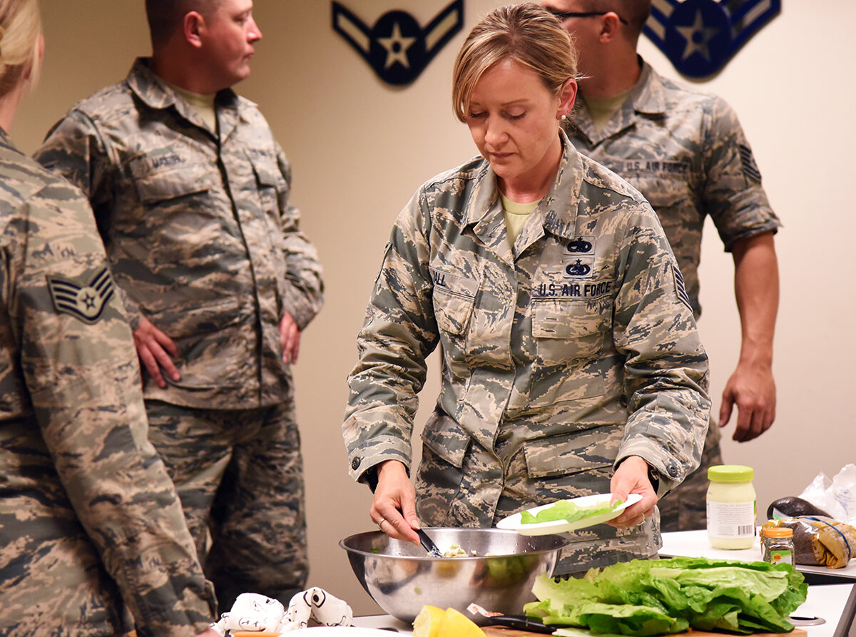 U.S. Air Force Tech. Sgt. Jennifer Hall, the new 173rd Fighter Wing health promotion coordinator, serves up some chicken salad lettuce wraps during a nutrition class, Sept. 7, 2019 at Kingsley Field in Klamath Falls, Oregon. The goal of these classes is to help educate and promote healthy food choices for Airmen. (U.S. Air National Guard photo by Tech. Sgt. Jason van Mourik)