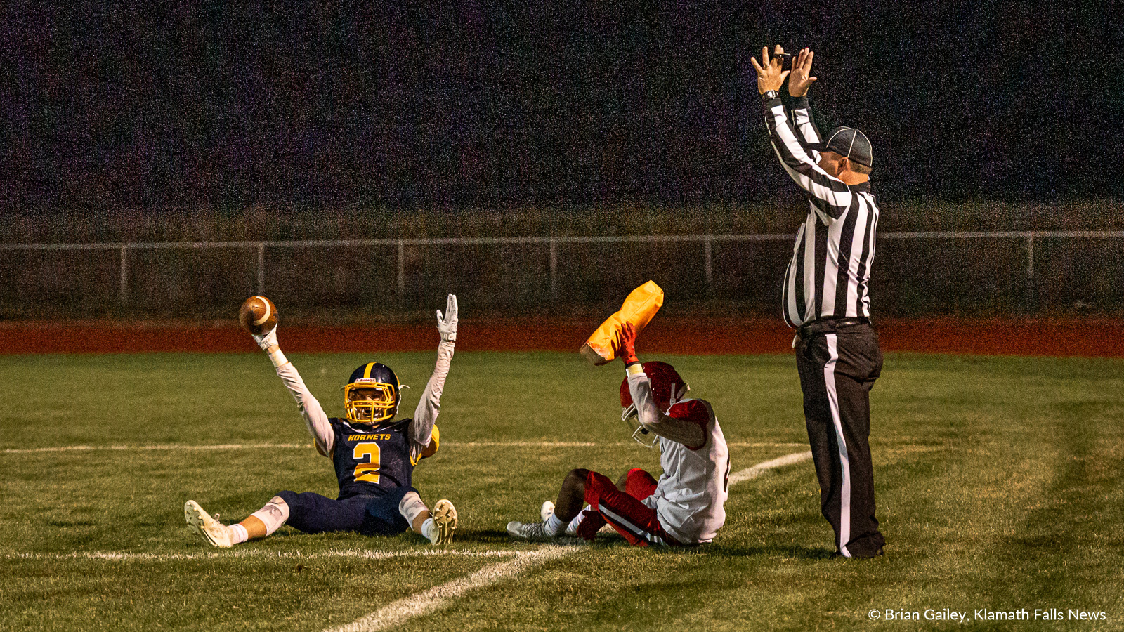 Henley's wide receiver #2 Gavin Graham celebrates with his arms in the air following a touchdown in the annual cross-town rival football game with Klamath Union. Henley defeated Klamath Union 35-6, Saturday night. September 27, 2019 (Image: Brian Gailey, Klamath Falls News)