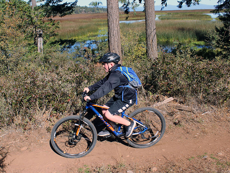 Will Grayson Will Grayson rides the trail along Shoalwater Bay during a 7.5-mile mountain bike race Saturday as part of the Shasta Elementary School Mountain Bike Club.