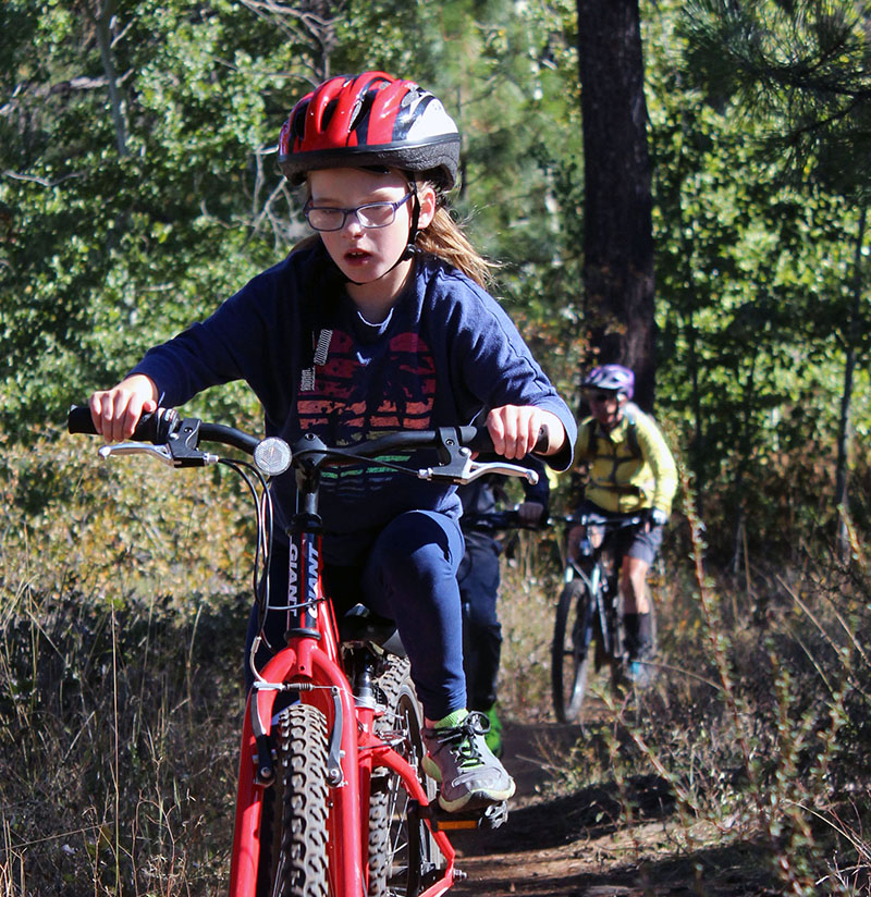 Mary Jane Harmon rides the trail along Shoalwater Bay during a 7.5-mile mountain bike race Saturday as part of the Shasta Elementary School Mountain Bike Club.
