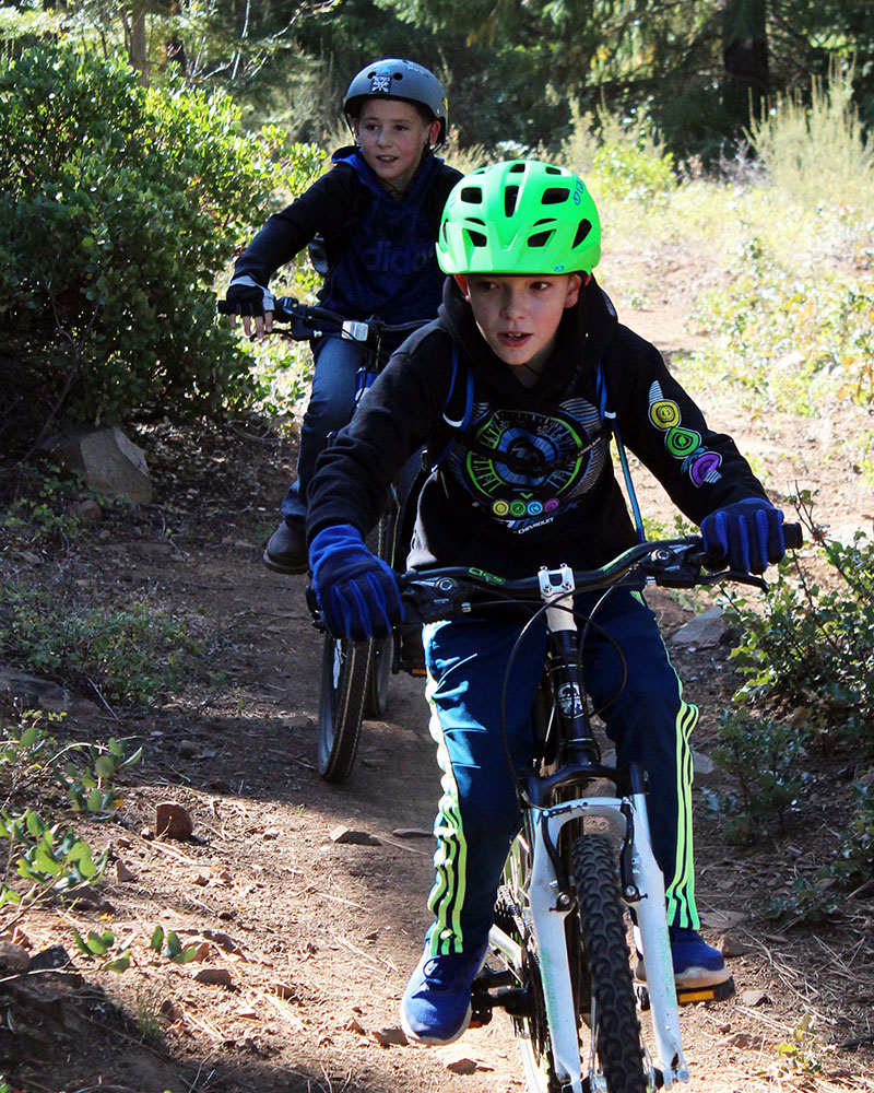 Drew Dodson and Connor Saveland ride the trail along Shoalwater Bay during a 7.5-mile mountain bike race Saturday as part of the Shasta Elementary School Mountain Bike Club.