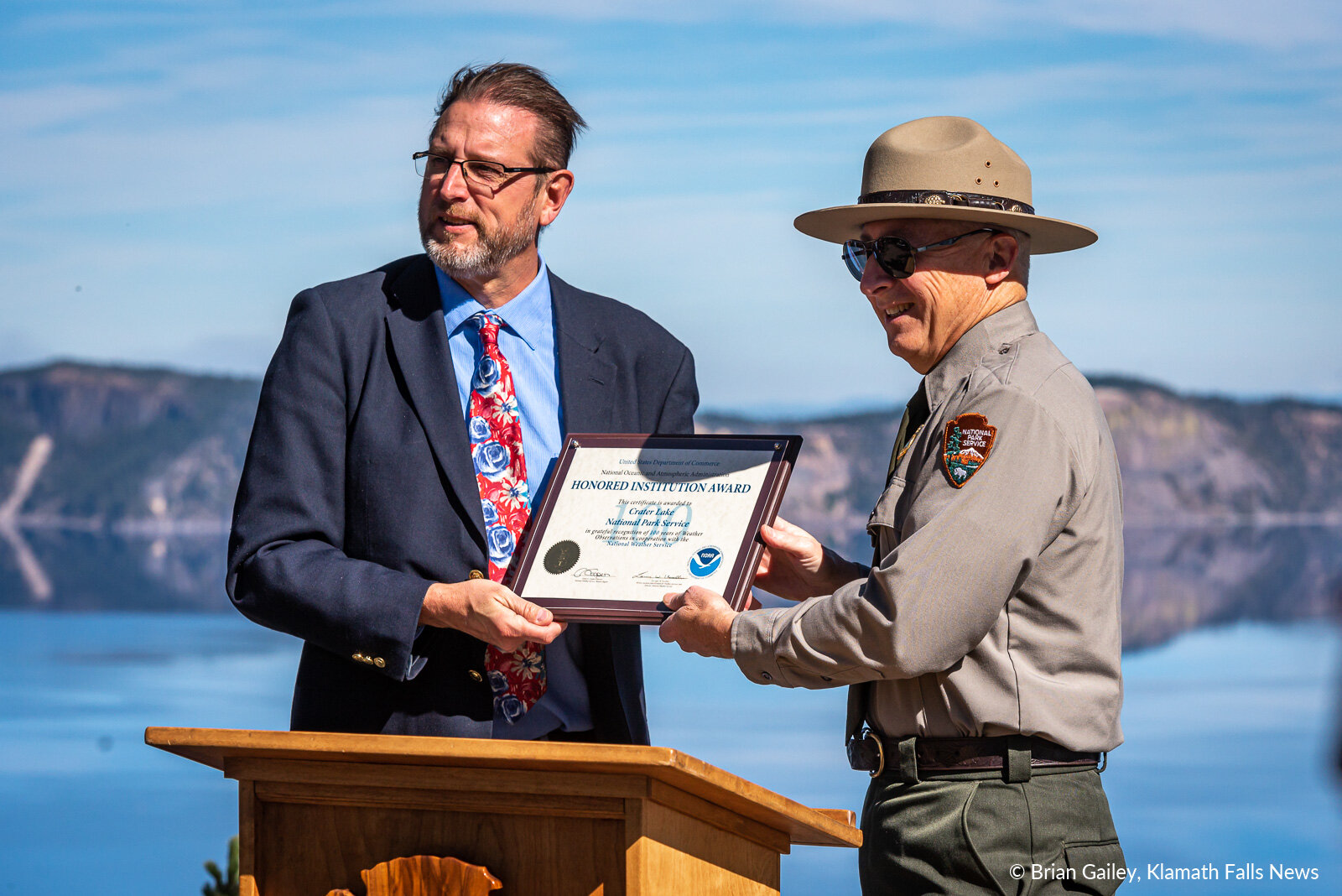 Crater Lake National Park Superintendent Craig Ackerman receives an Honored Institution Award from the National Weather Service on behalf of Crater Lake NP for 100-years of weather observations within the park. October 7, 2019 (Image: Brian Gailey / Klamath Falls News)
