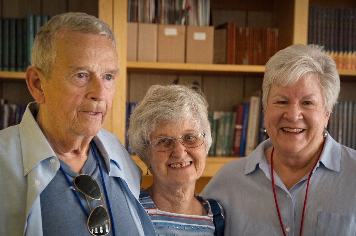 Jayne Stuntebeck, center, poses with two of her former high school students, Larry Ferguson and Susie Kaylor, both Henley High Class of 1958.  Photo by Morgan Abramson