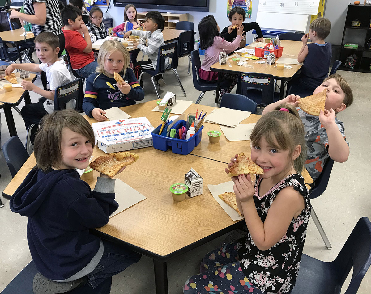 Chiloquin Elementary school students eat their pizza Tuesday via pizza delivery.