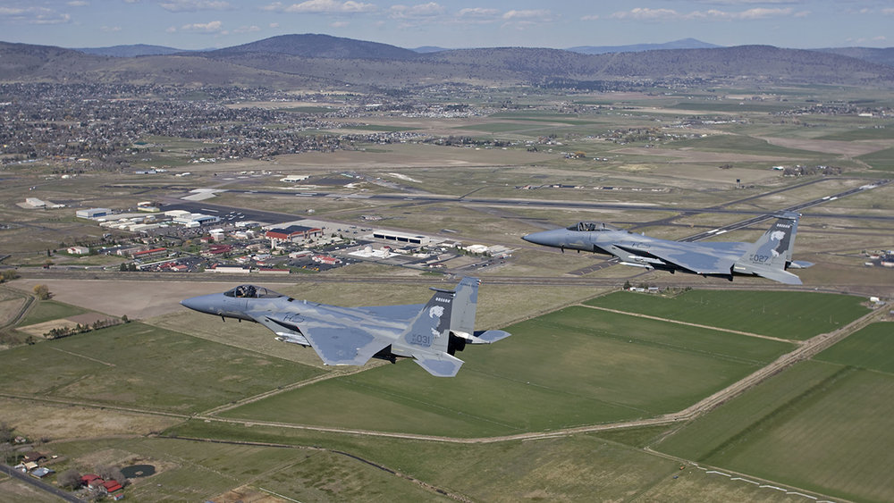 Two F-15 Eagles from the 173rd Fighter Wing out of Kingsley Field fly over Klamath Falls, Oregon during a routine training mission. The 173rd FW is home to the sole F-15C training base for the United States Air Force. (Courtesy photo by Jim Haseltine)
