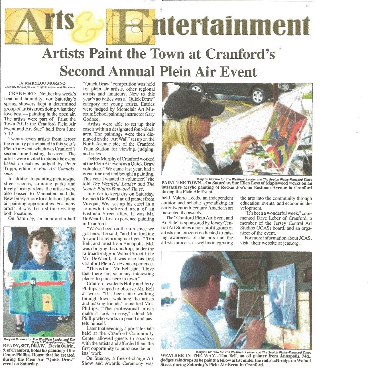 The artist pictured while painting in the Cranford event (at upper right).