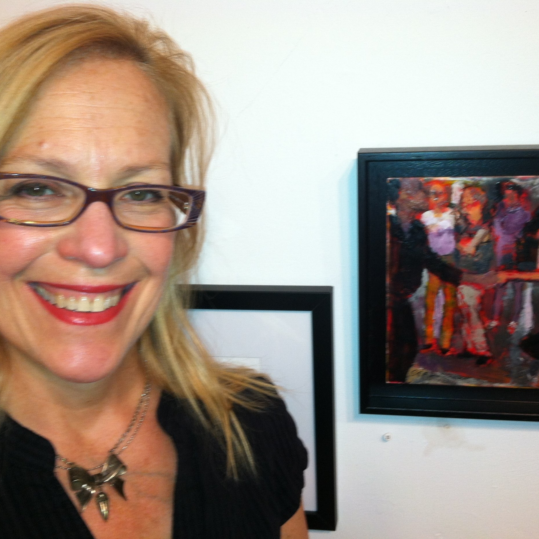 The artist with her encaustic showing at the Pierro Gallery.