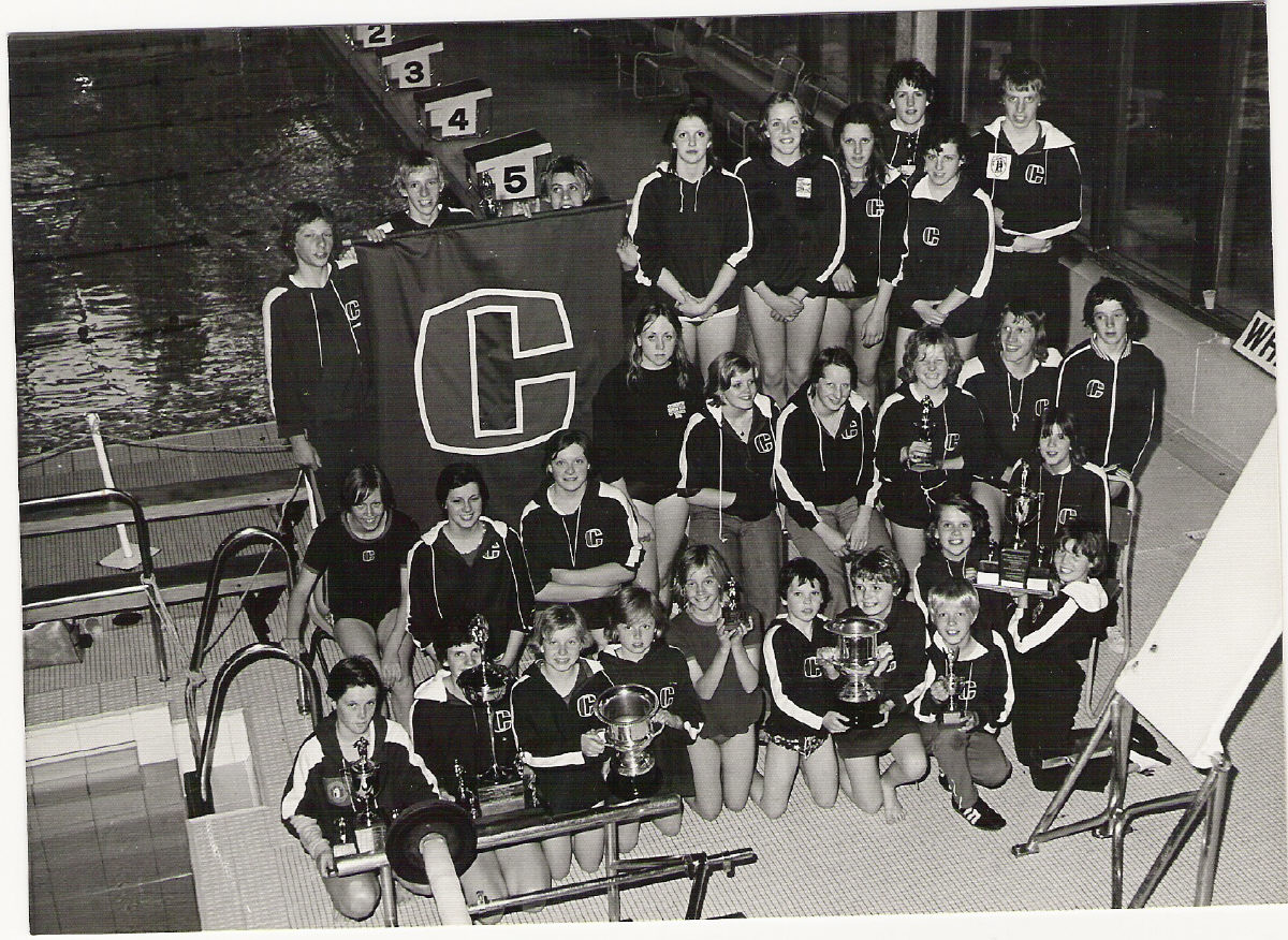 That's me with the curly hair and a silly grin on the front row holding a trophy in 1976 (aged 11) at  Coventry Swimming Club