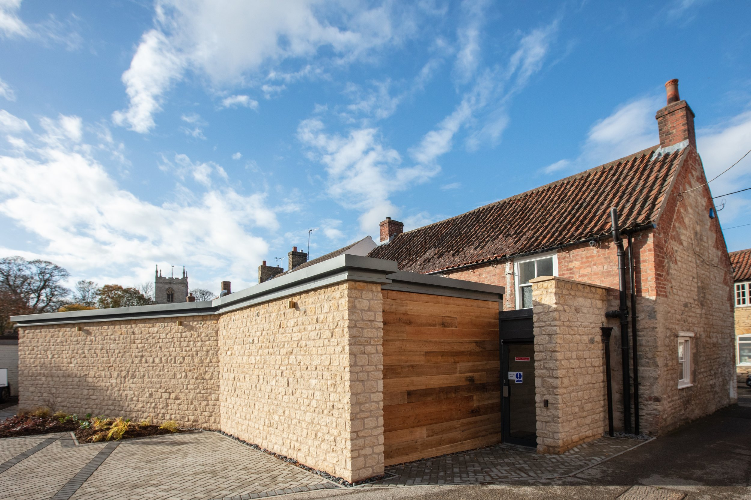 DAVID burgharDt opticians, nettleham  extension - to a grade II listed building