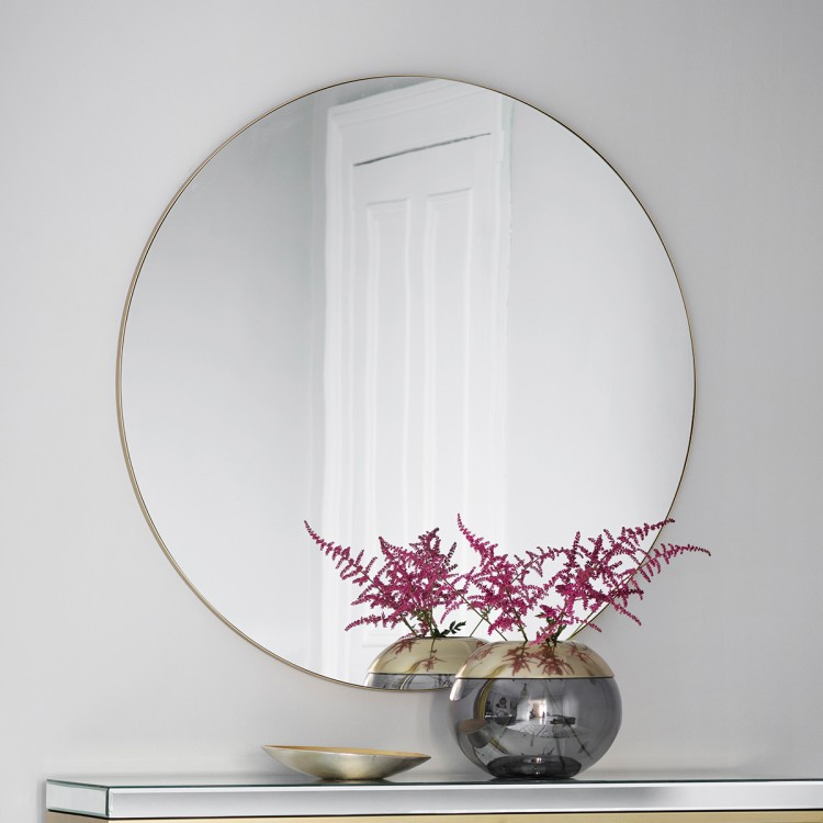 Alia Mirror - Two colour options Black/Champagne FrameDia 100cmRRP € 710For enquiries please call us today on +353 1 4534742 or email info@interiorsatelier.ie