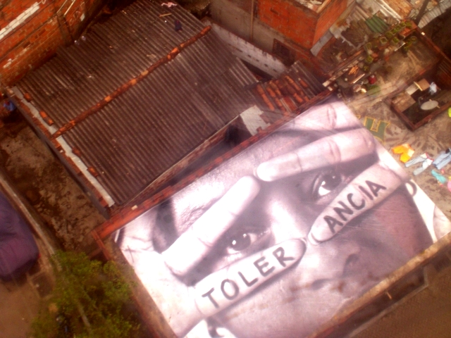 Medellín, Colombia. Images of people and words of empowerment on the rooftops.