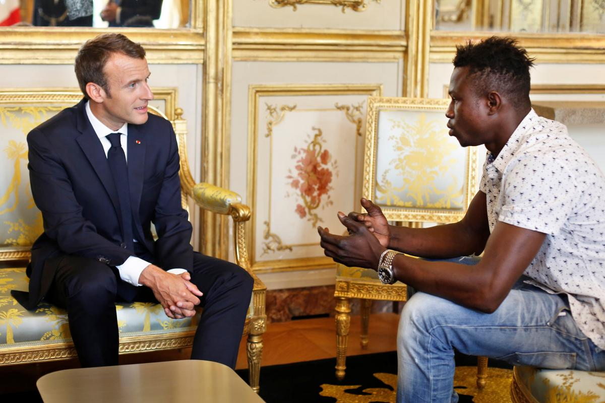 French President Emmanuel Macron (L) meets with Mamoudou Gassama, 22, from Mali, at the Elysee Palace in Paris, France, May 28, 2018. Thibault Camus/Pool via Reuters