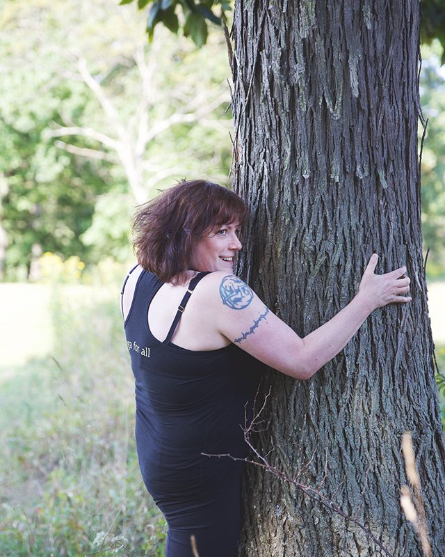 Ever hugged a tree??? If you haven't, I suggest it ⁣ ⁣.⁣ ⁣I hug and breathe several times, noticing how strong and certain the tree is, and then I notice how strong and certain my body is ⁣ ⁣.⁣ ⁣I especially appreciate this practice as it relates to chronic illness,  pain, and disability, because trees grow in all kinds of weather - they are rarely 'perfect' in shape…. They can have scars, etc⁣ ⁣.⁣ ⁣Just like me⁣ ⁣.⁣ ⁣So go hug a tree today, while we still have them ⁣ ⁣.⁣ ⁣——— image is of white woman dressed in black yoga pants and a black tan top hugging a tree while looking over her right shoulder and smiling.  The woman is me⁣ ⁣.⁣ ⁣.⁣ ⁣.⁣ ⁣.⁣ ⁣.⁣ ⁣.⁣ ⁣.⁣ ⁣.⁣ ⁣.⁣ ⁣.⁣ ⁣.⁣ ⁣.⁣ ⁣.⁣ ⁣.⁣ ⁣.⁣ ⁣.⁣ ⁣.⁣ ⁣#kayteezee #hugatree #treehugging #selfcare #selflove #chronicpain #chronicillness #disabilityawareness #treesgiveuslife
