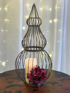 Wire mulit-shaped orb has opening in base to allow decorative items to be placed inside.