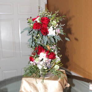 Shown filled with roses and greenery to create a major focal piece.