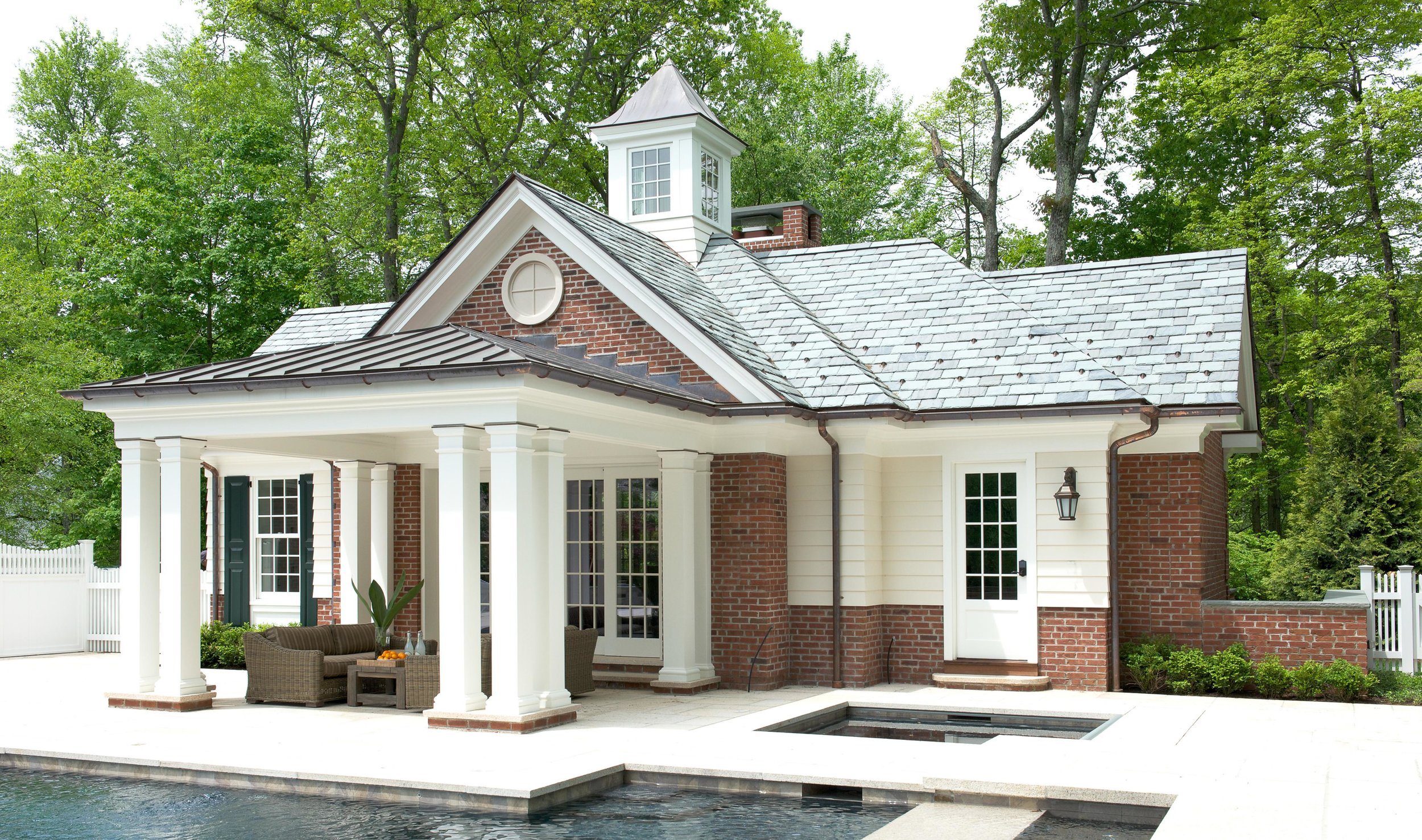 Brick pool house with slate and copper roof
