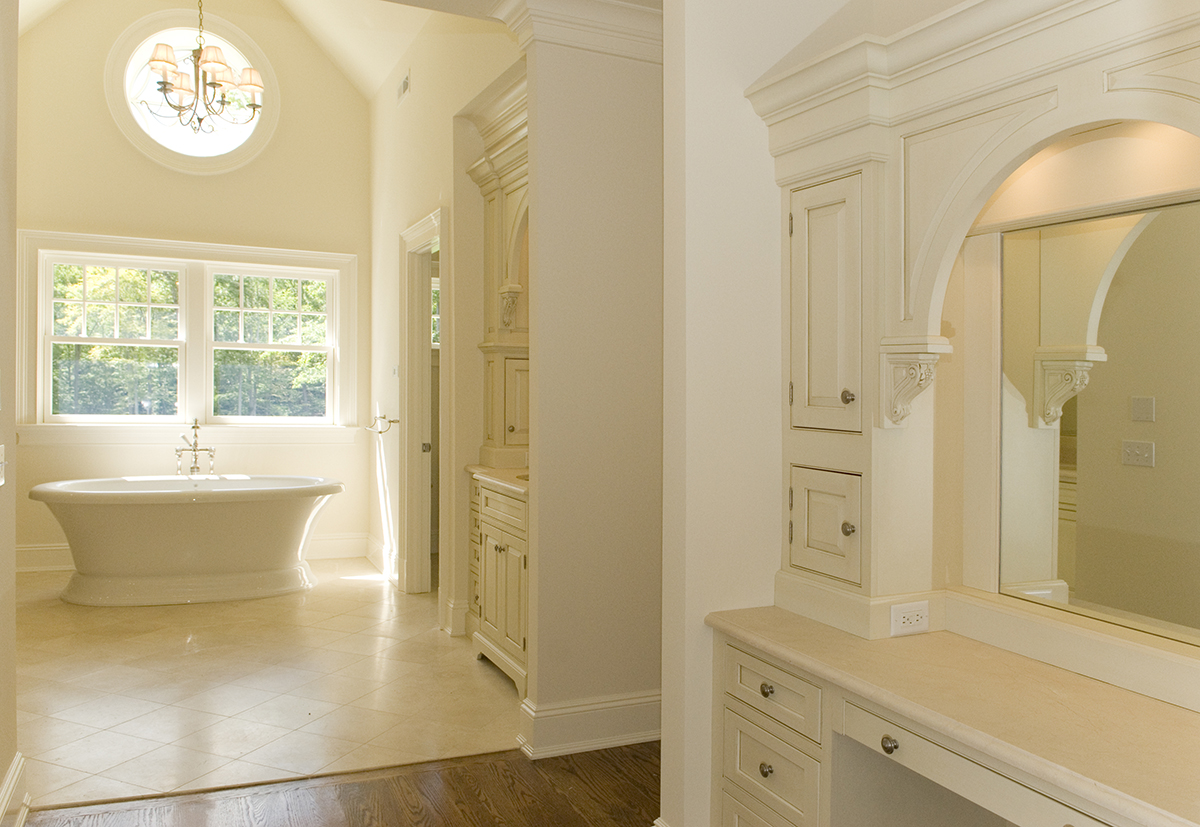 Cathedral master bath with rose window