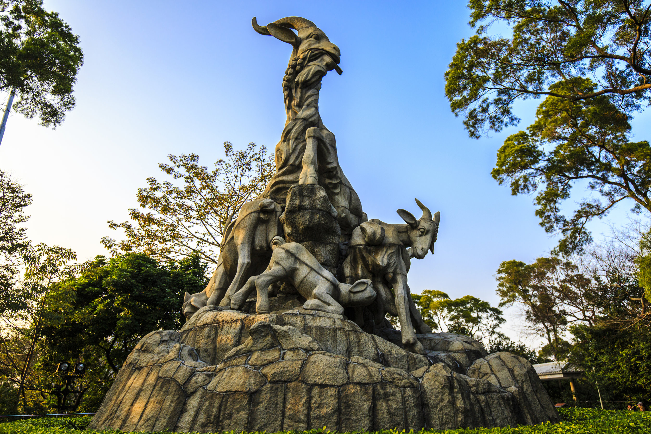 """An ancient legend tells of five celestial beings descending upon the city of Guangzhou, riding five rams of differing colors, during a time of terrible famine. In the mouths of each of the rams were special sheaves of rice, which the celestial beings bestowed upon the people of Guangzhou, in order to save the city from starvation and ensure that they would never suffer from famine again. As a testament to this story, a sculpture of five rams currently stands in the city's Yuexiu Park (pictured above),earning Guangzhou the nickname """"The City of the Five Rams""""."""