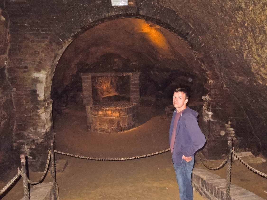 Marcin inside the Etruscan cave under Cantina De Ricci in Montepulciano, Italy