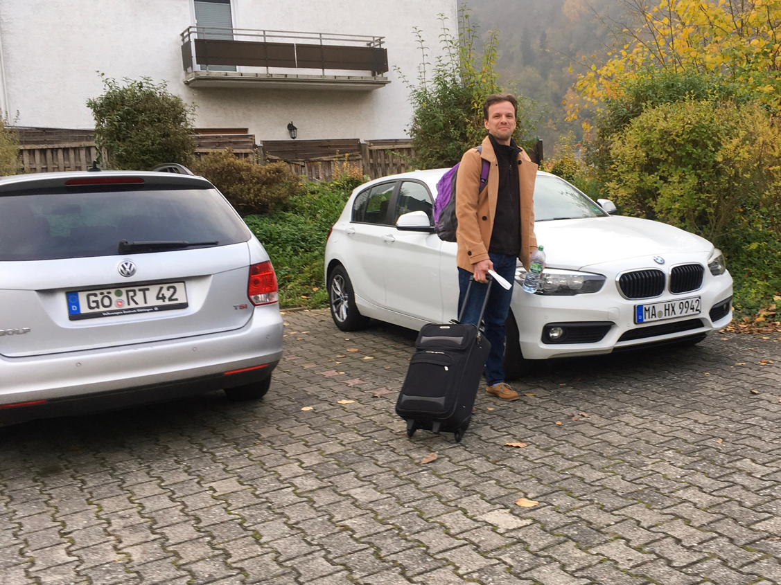 Marcin getting into our  Sixt  rental car in Germany.