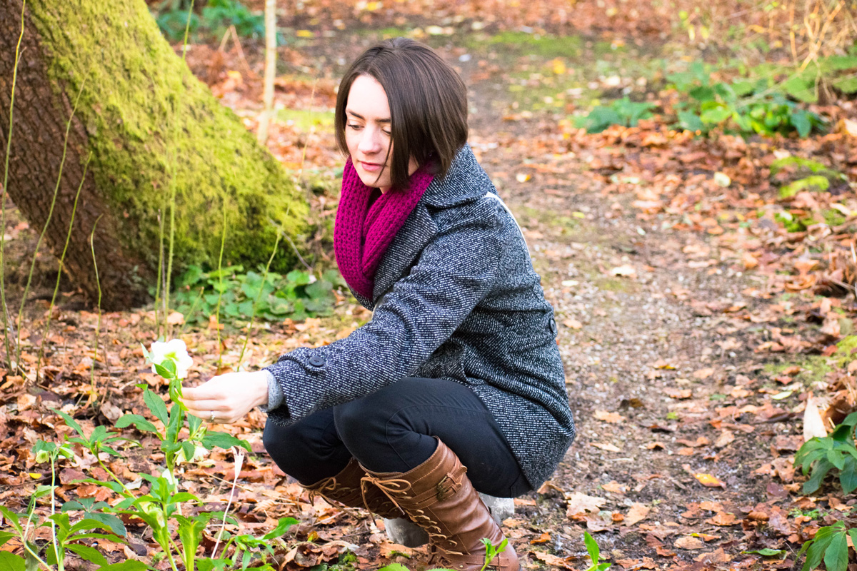 Delisa getting a closer look at one of the last remaining flowers in the Cluny House Gardens