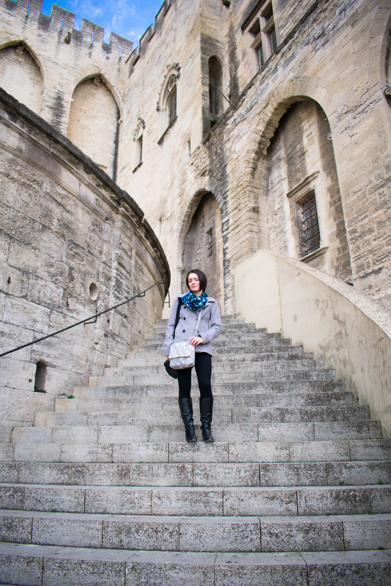 Delisa on the steps of Palais des Papes (Palace of the Popes)
