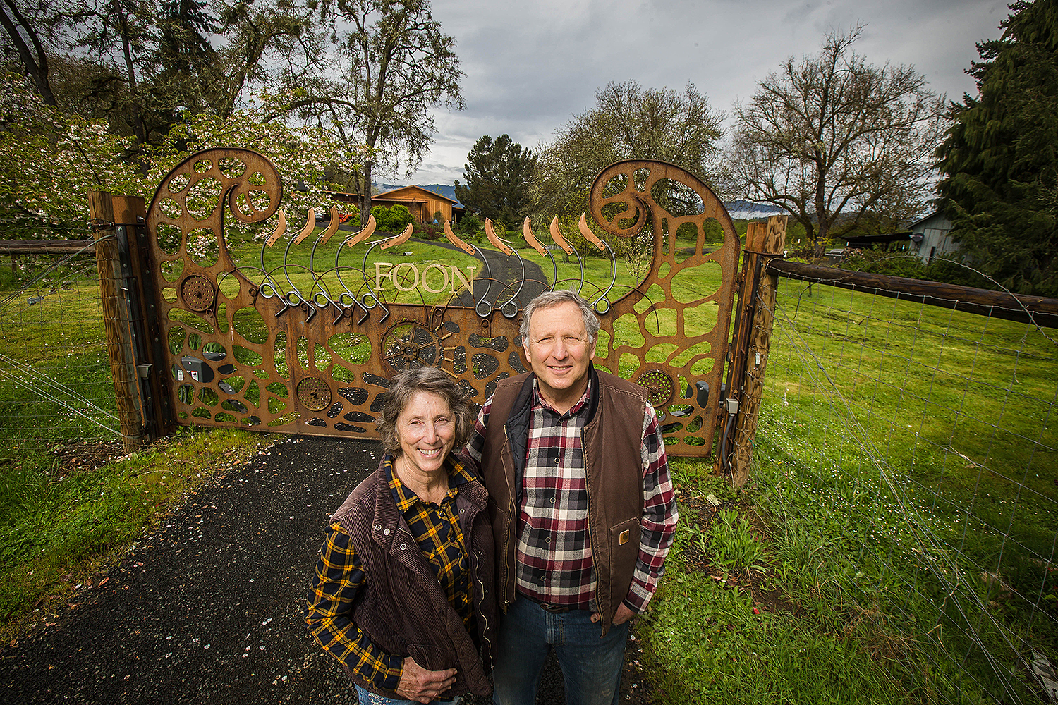Dr. Howard and Marjorie Feldman in front of the ornate entry gate he designed and fabricated.