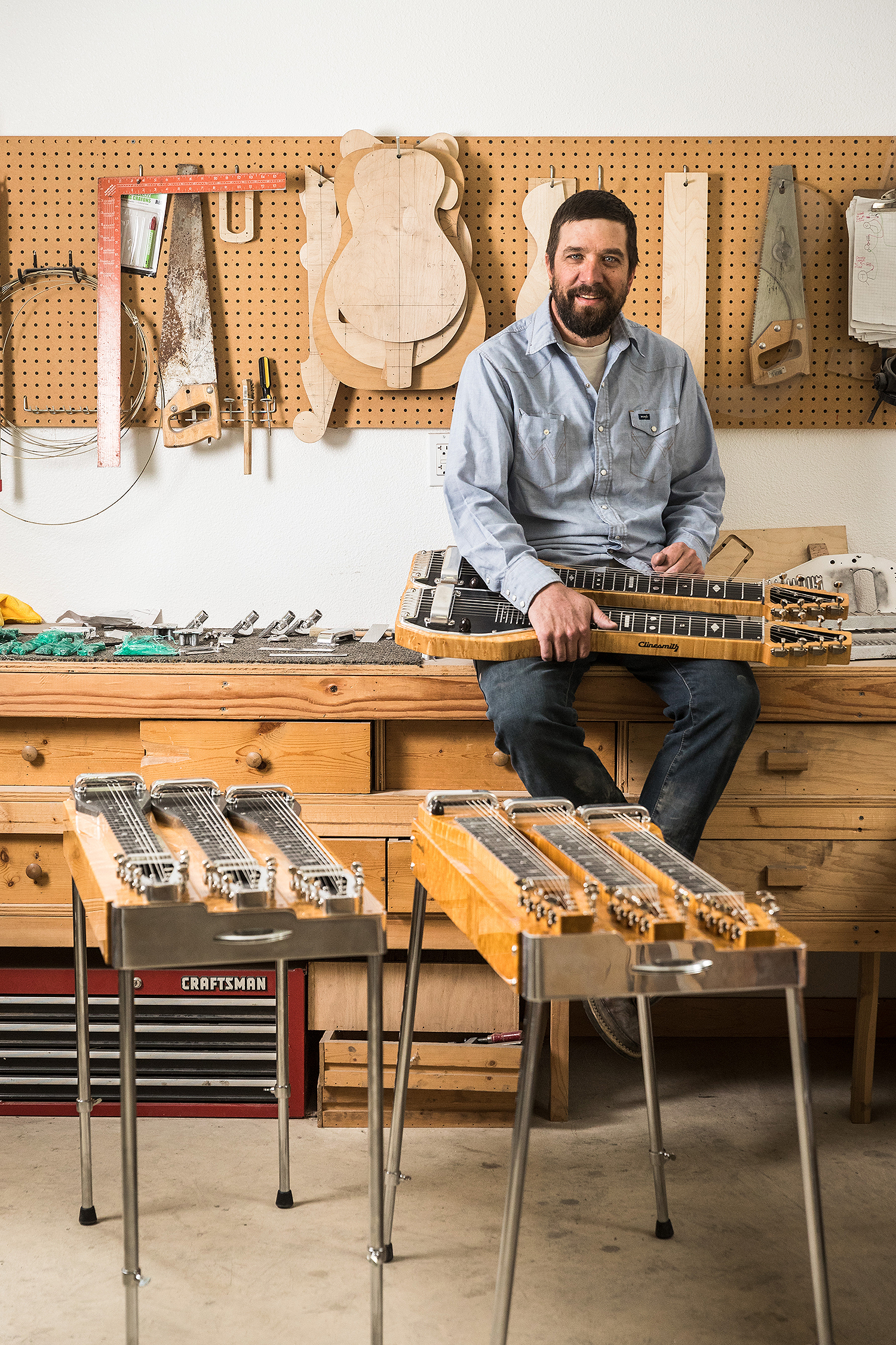 Todd Clinesmith and a couple of his coveted steel guitars.