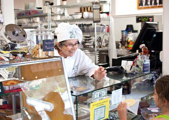 Goodog Bakery owner Jerrie Thomas helps a young customer.