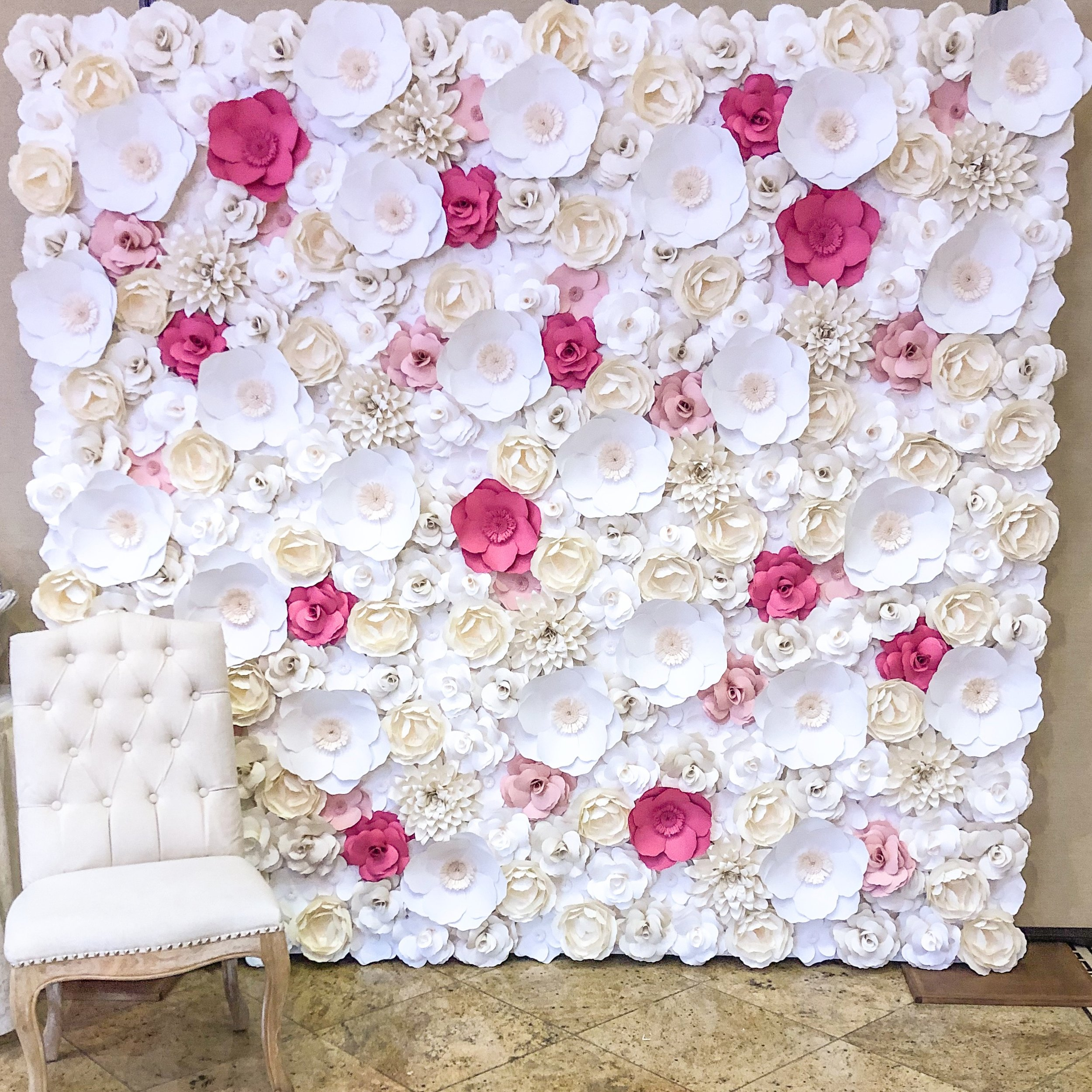 Paper Flower Wall - Rental Rate: 400.00Dimensions: 8' H x 8' LQuantity Available: 1Colored flowers can be added for an additional 50.00 as shown in photo.
