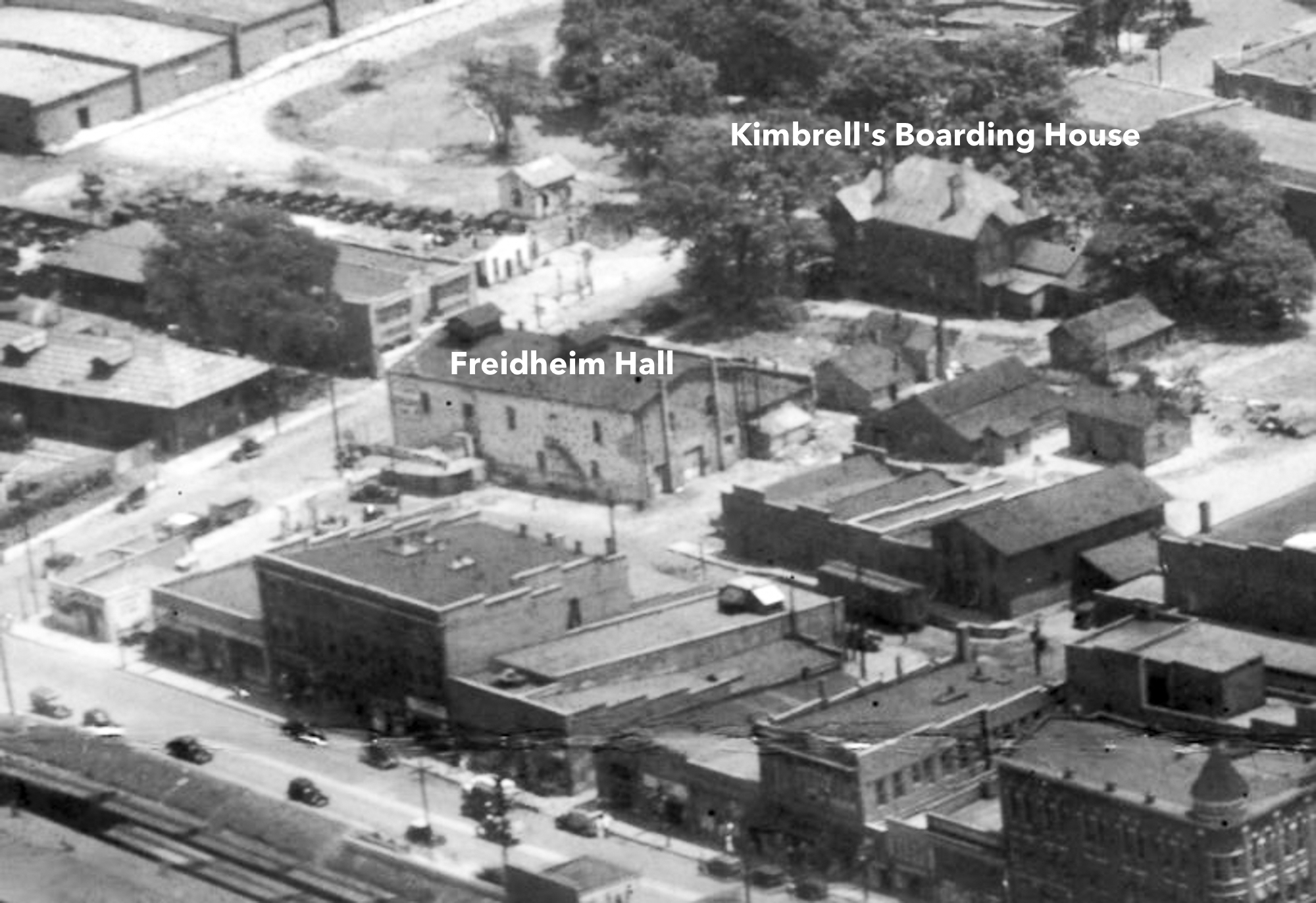 Aerial view showing Kimbrell's Boarding house across the street from Freidheim Hall