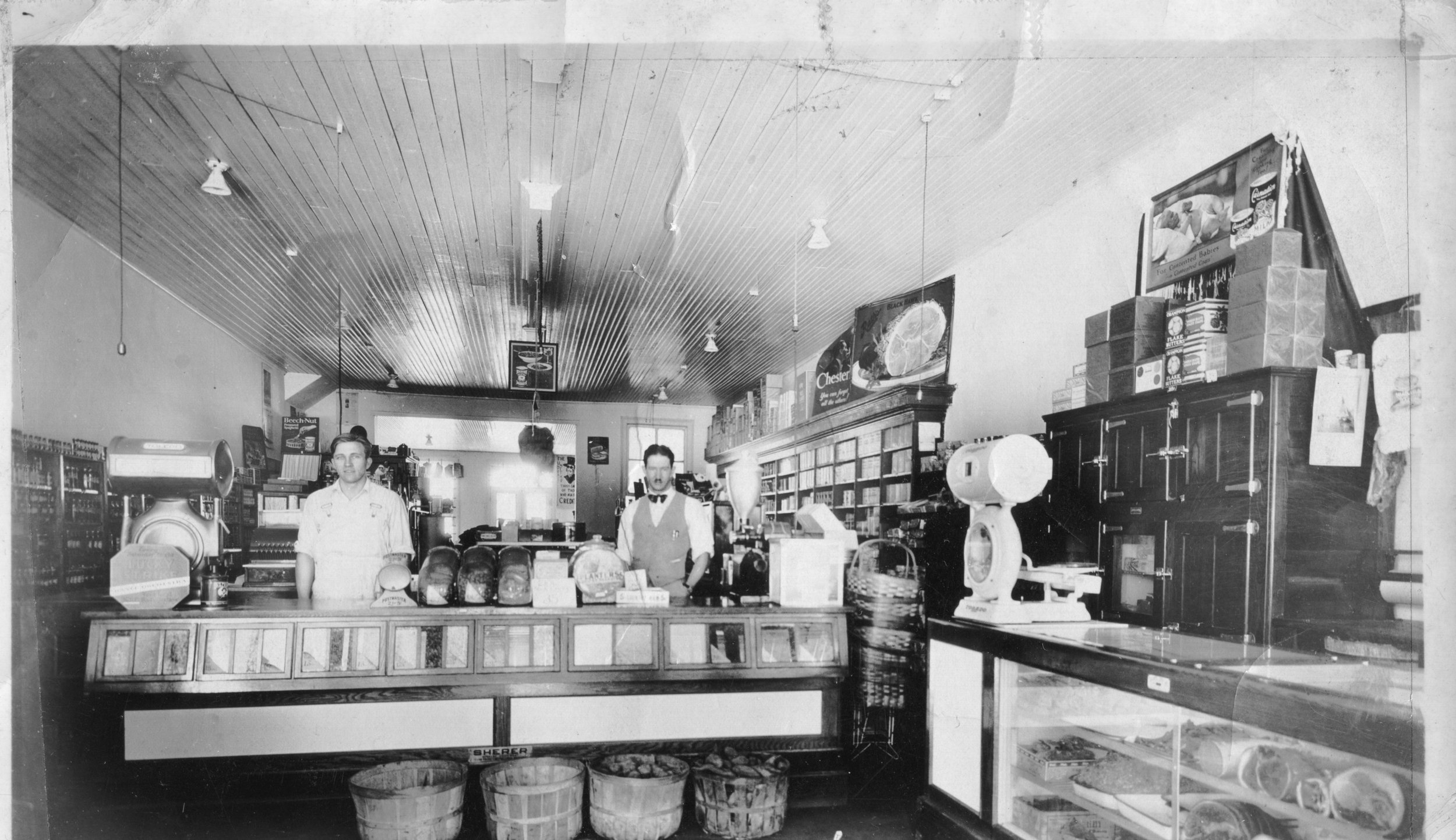 1929 - Frank Armstrong and J.B. Mills Jr inside Mills Mercantile.