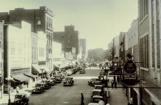 View of Main Street, ca. 1940, looking east with RH Hardware's sign to the right.