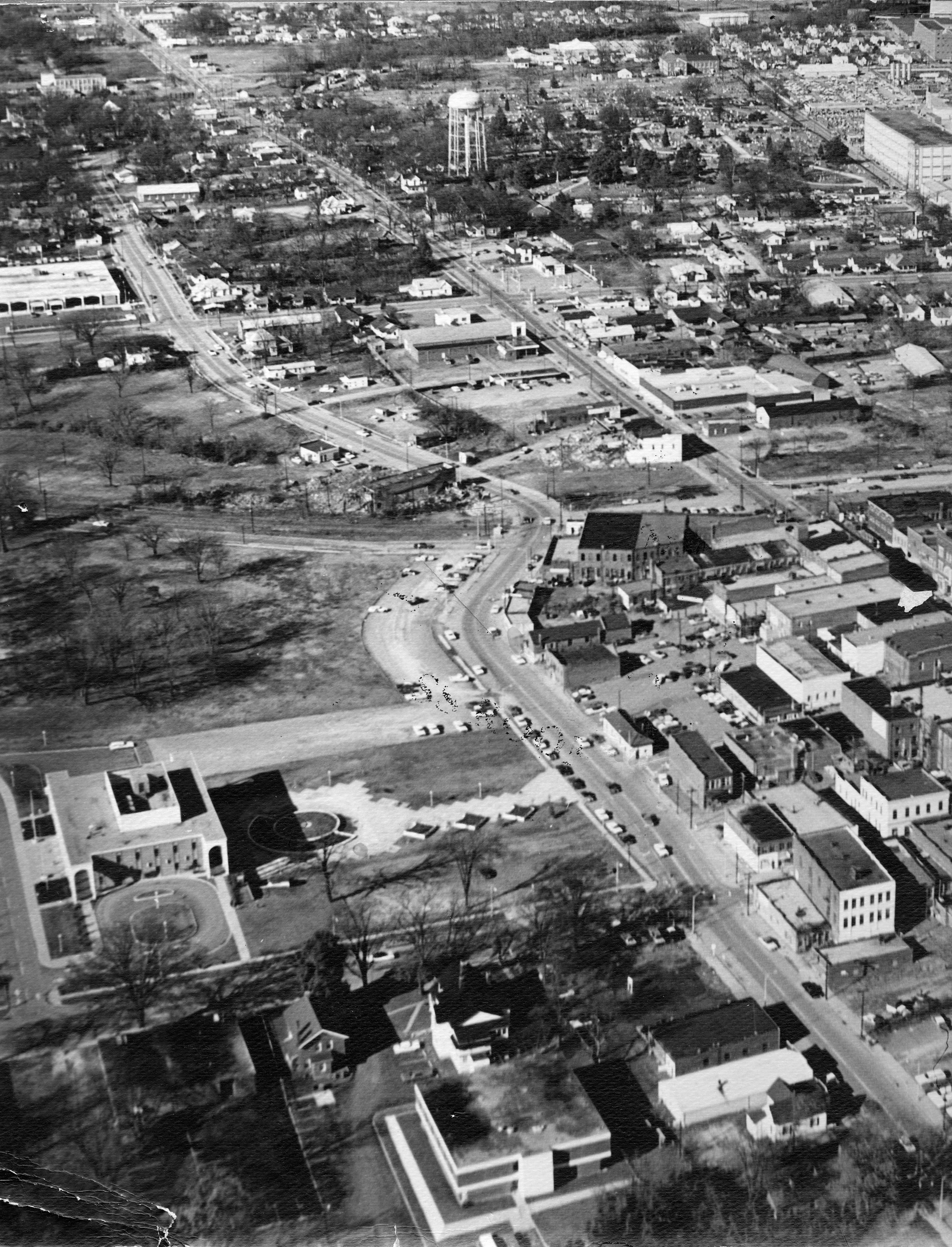 Straightening East Black Street was an important aspect of RH's downtown re-development. The vacant area in the middle-left section of this photo was where Tommy's Place was housed.