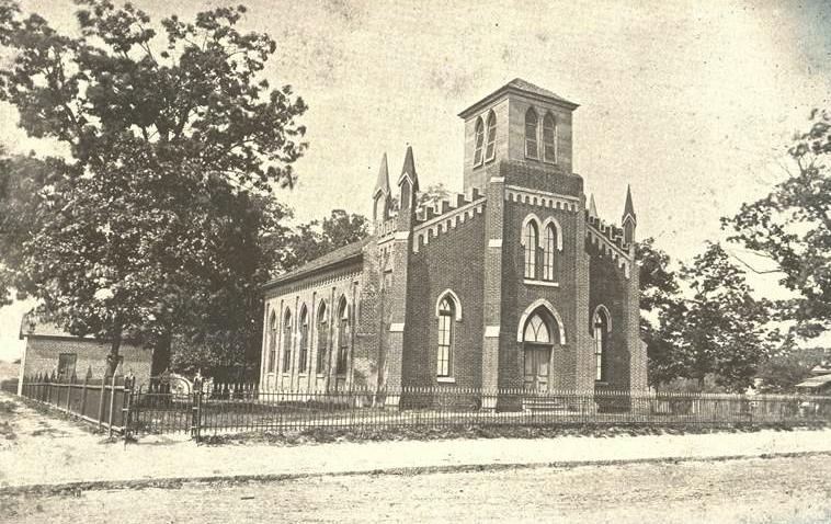 Image of the original First Presbyterian Church building to be constructed on his corner.