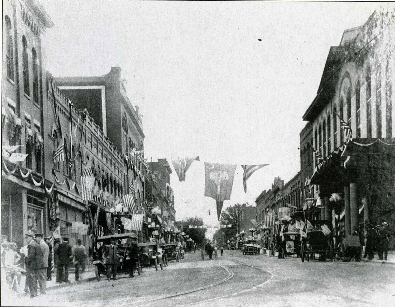 Ca. 1910 image of downtown Rock Hill looking east. Note the early cars as well as the trolley tracks which turned from Main Street onto North Trade Street.