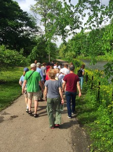 Community Steward Jaclyn Peterson leads a pre-workday nature walk to introduce volunteers to native species around the Humboldt Park lagoon