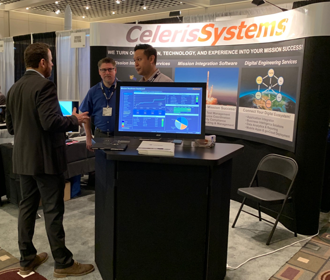 Celeris Systems Vice President Rob Enrico and Senior Systems Engineer Randy Powers share iRIS® mission integration capability with a conference attendee.