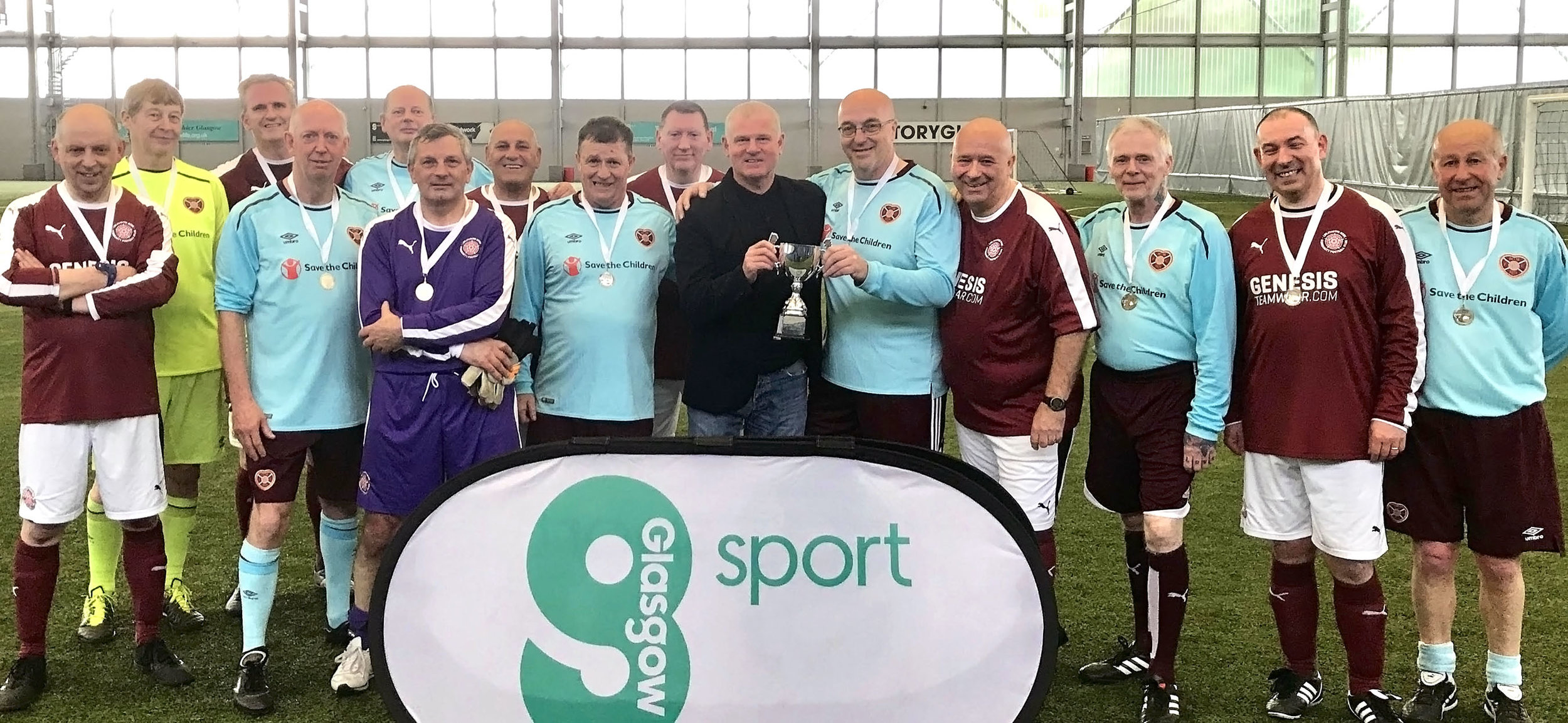 Ian Durrant making the presentation to Glasgow Cup winners Heart of Midlothian and runners up Linlithgow Rose.