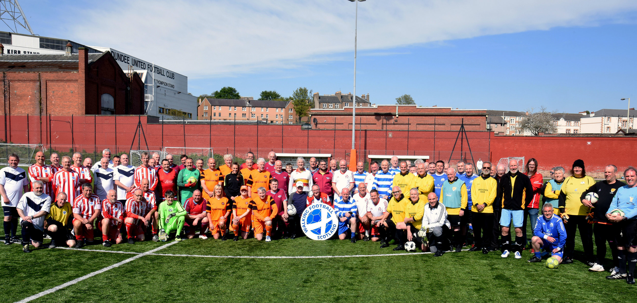 The teams line up with Dundee United Community Trust's Mel Gormley before the start.