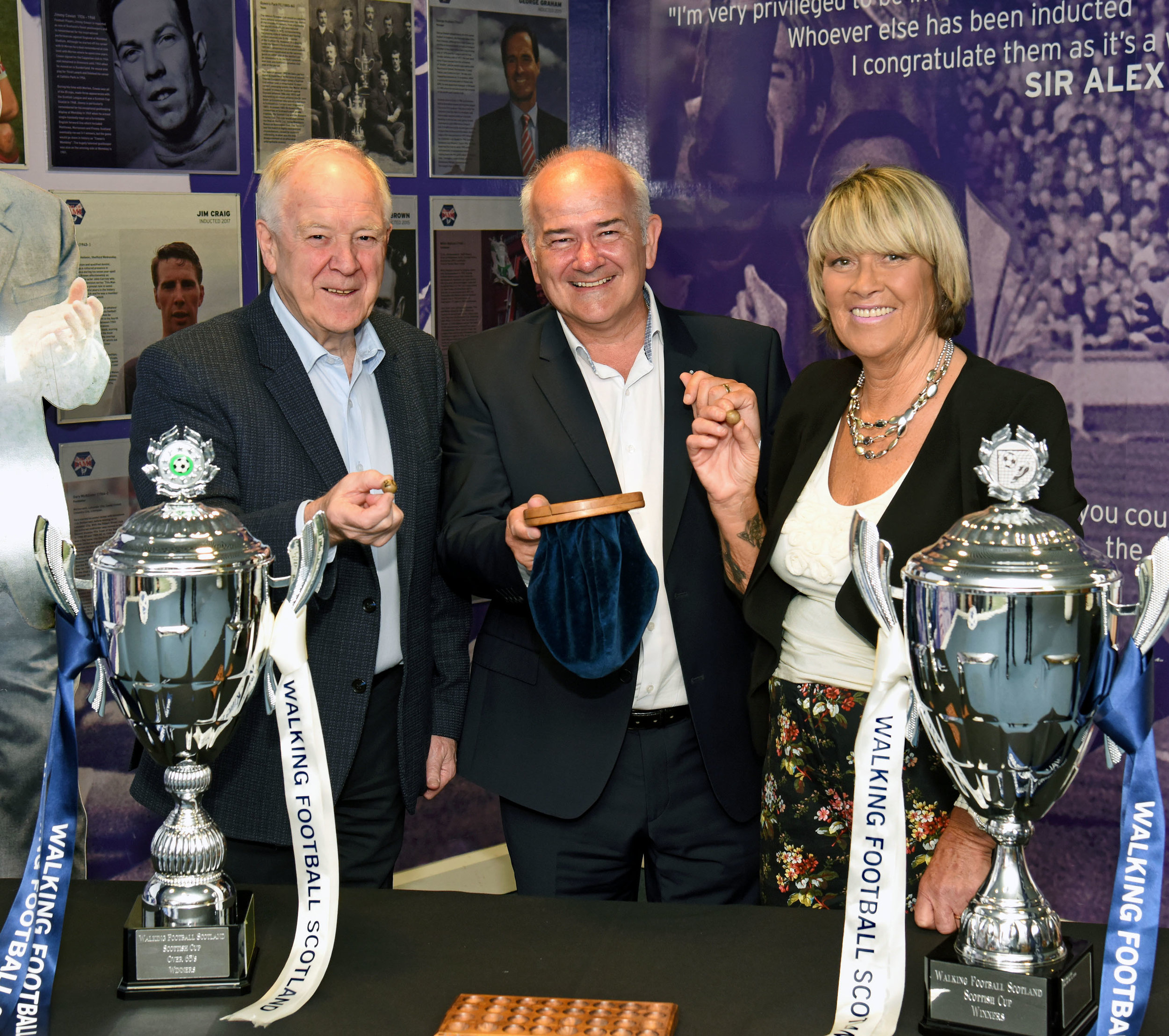 Walking Football Scotland Patrons Craig Brown and Rose Reilly join WFS Chair Gary McLaughlin (centre) for the draw in the Scottish Football Museum at Hampden Park in Glasgow.