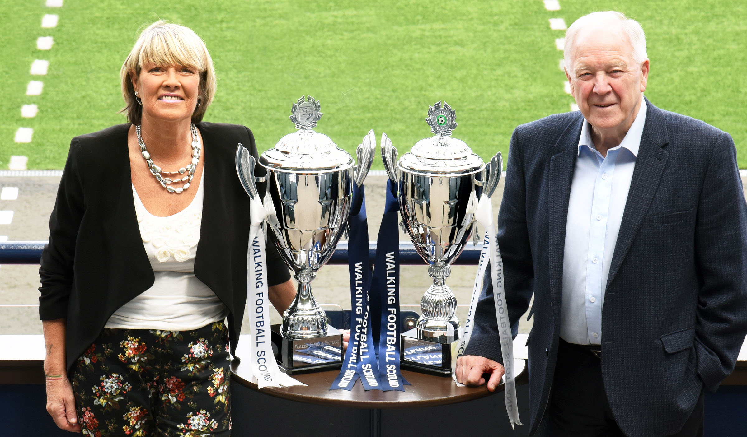 WFS Patrons Rose Reilly and Craig Brown with the WFS Scottish Cups.