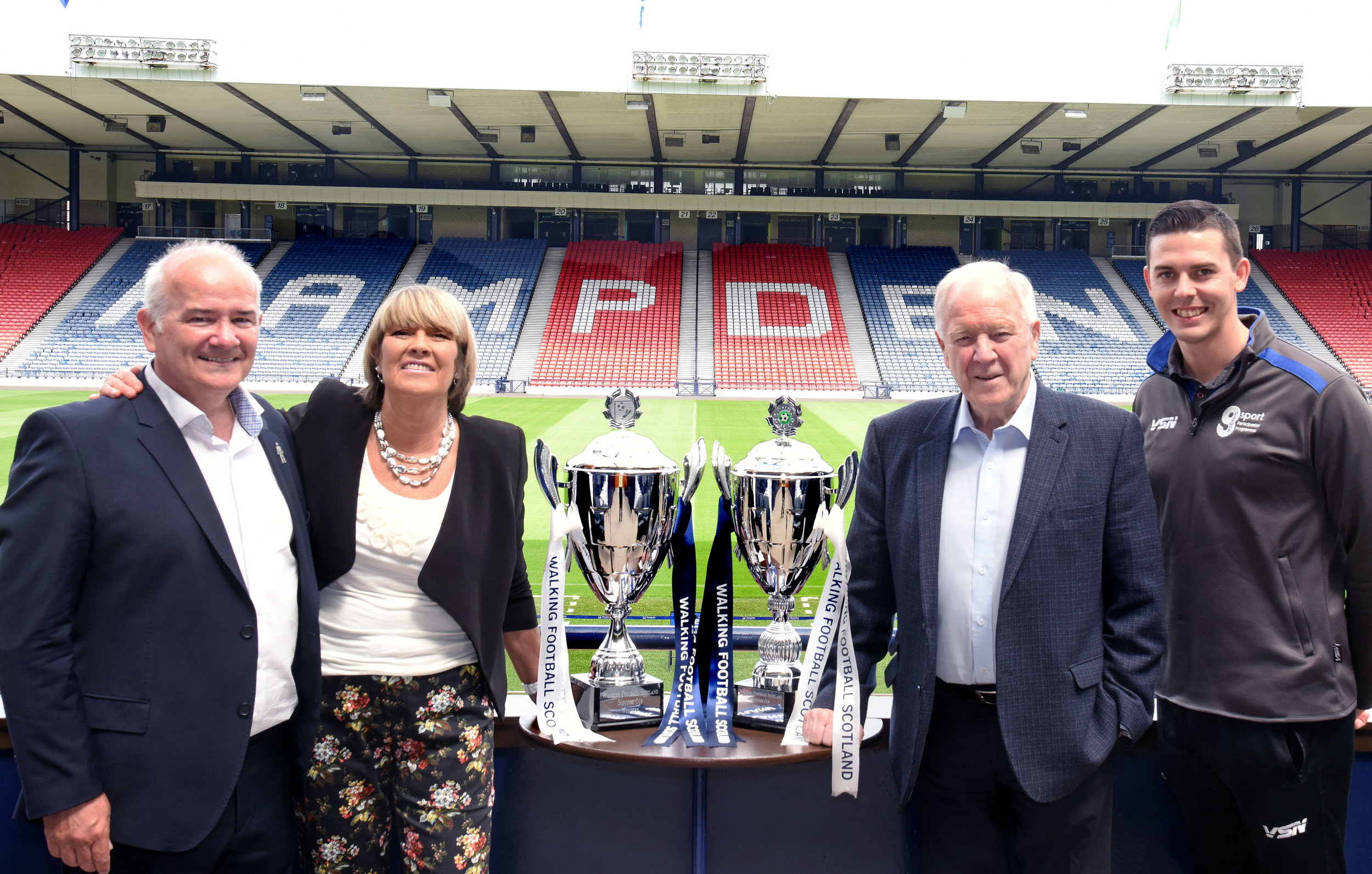l-r Gary McLaughlin and Rose Reilly beside the Over 50's Scottish Cup, Craig Brown and Matt Ramsay closest to the new Over 65's Scottish Cup