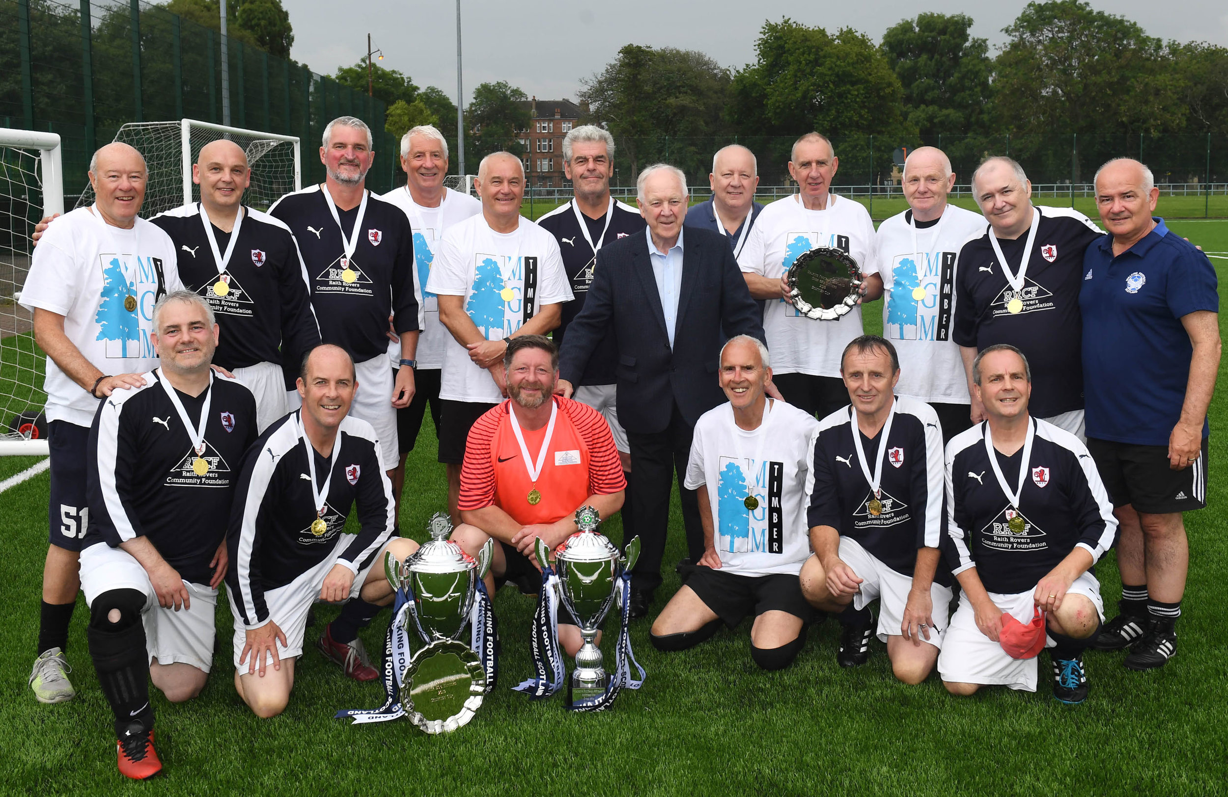 Scottish Champions Over 50's Raith Rovers (Blue) and Over 65's Kirkcaldy (White) with Craig Brown and WFS Chair Gary McLaughlin
