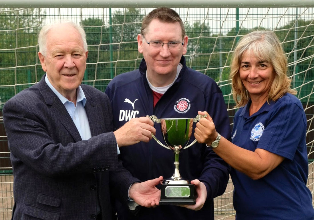 Linlithgow Rose Winners of the Peter Collins Award for Fair play in the competitive Scottish Cup.  David Callaghan receives the trophy from Craig Brown and WFS Trustee Vivian Wallace