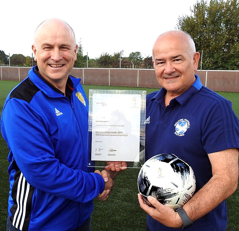John Brown, South West Regional Manager at the Scottish FA presents Gary with his Award.