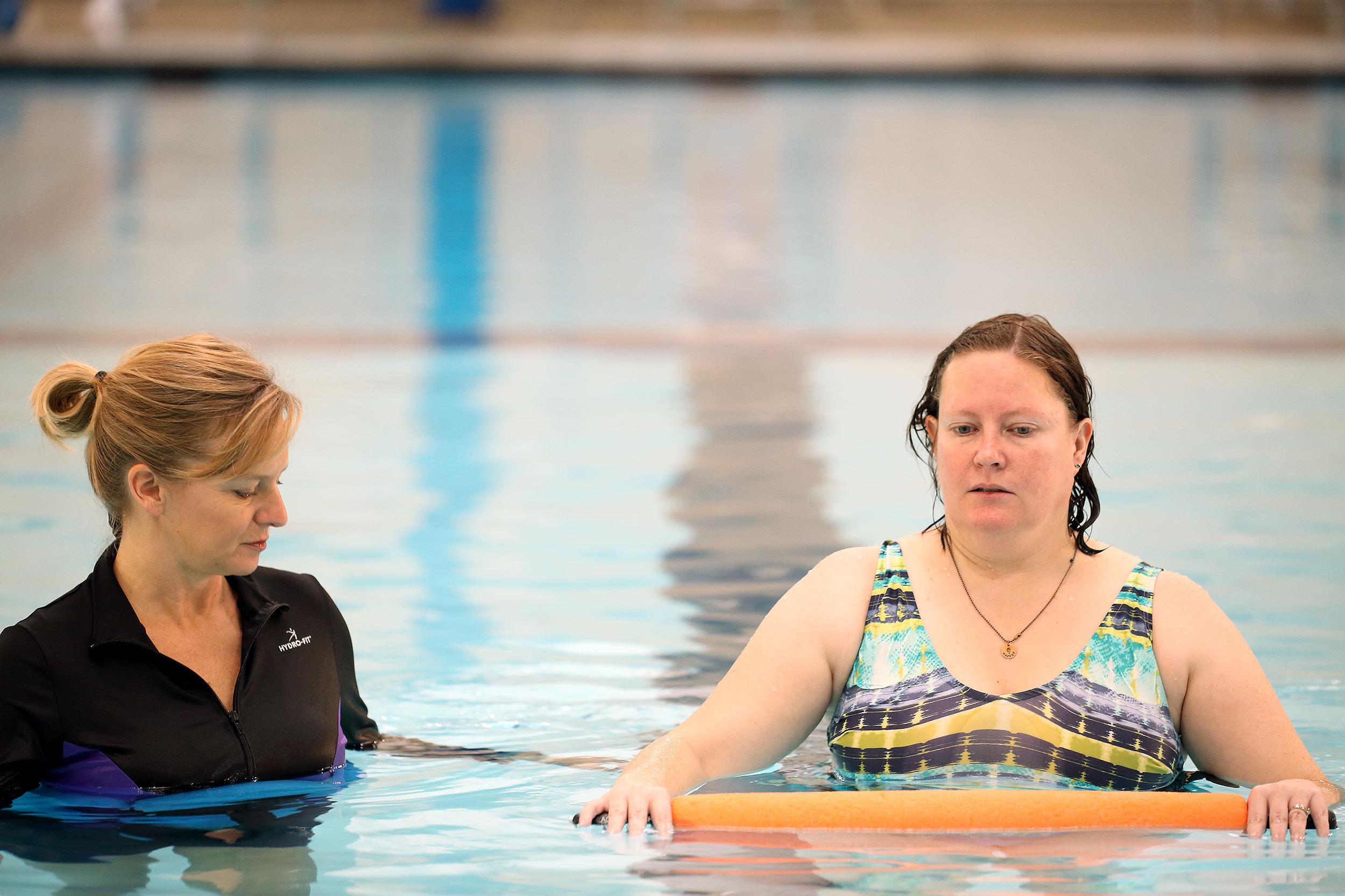 nancy-with-patient-in-pool2.jpg